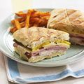 Cuban Sandwiches--a family favorite.  Soft hoagie roll, pulled or sliced roast pork, ham, swiss or pepperjack cheese, fresh sweet onions, dill pickles, yellow/brown/or sweet hot mustard.  Grill the inside of the hoagie in garlic butter--flip--assemble--press and grill until crisp.  Yummmm!!!