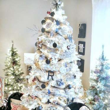 Woodland Black and White Christmas | Taryn Whiteaker picked up wooden ornaments to create this beautiful tree. The white ornaments continue the white motif and a strand of black and white ribbon breaks up all that white perfectly.Check your Christmas lights with a Christmas light tester. Photo: Courtesy of Taryn Whiteaker | https://tarynwhiteaker.com/black-white-woodland-christmas-tree/