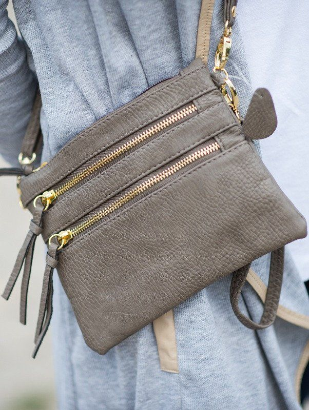 This bag is the perfect fashion accessory - it's three exterior pockets and one interior pocket make it great for organizing all your items. It's versatility also allows it to be worn as crossbody, wr