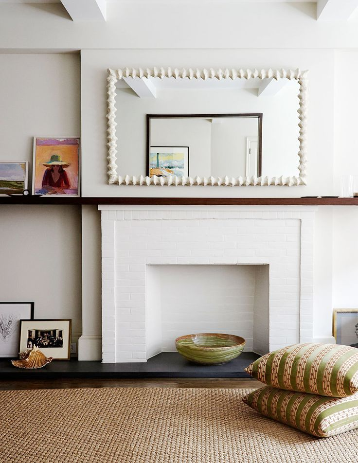 extended mantel and art with mirror | room of the week via coco kelley