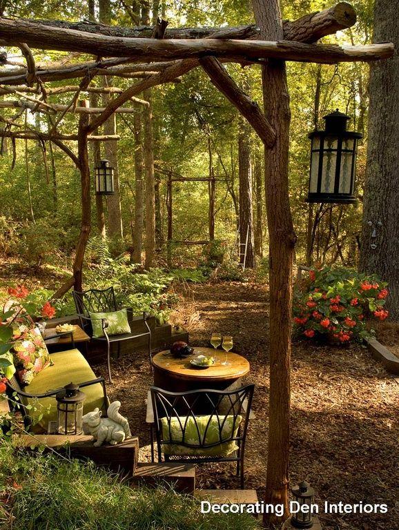 Rustic Landscape/Yard with Natural wood trellis, Iron lanterns, Natural Branch Arbor Tutorial, Rod iron furniture