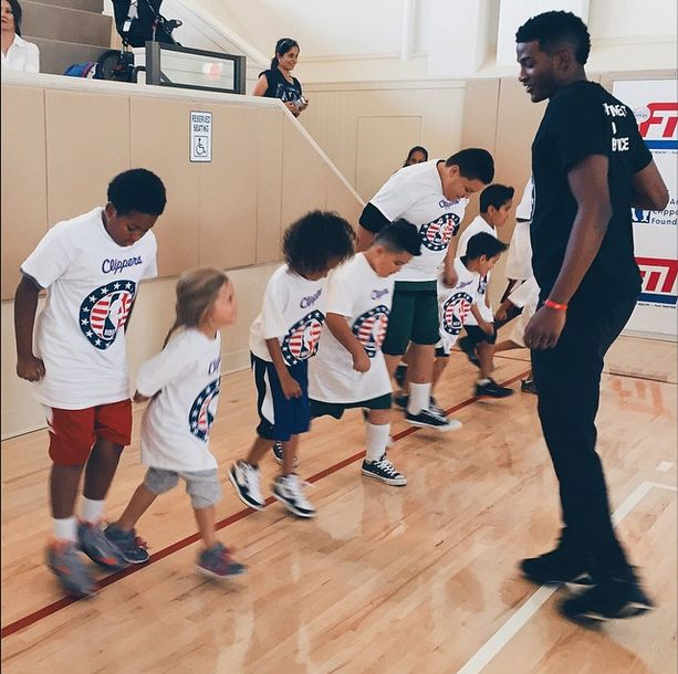 Rookie, C.J. Wilcox giving a lesson on basketball fundamentals to the children of military personnel at the Clippers Hoops for Troops Basketball Clinic. #HoopsForTroops