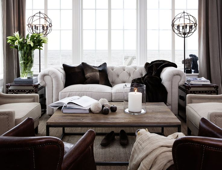 Tuffed sofa, lamps, many chairs, and are those mirrored trunks asvend tables? Love all of this