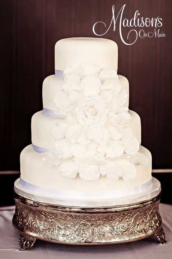 Blooming rose wedding cake..... - White fondant with white satin ribbon at the base of each tier.  I made the center rose and petals from white fondant.  Photo by Kevin Paul Photography