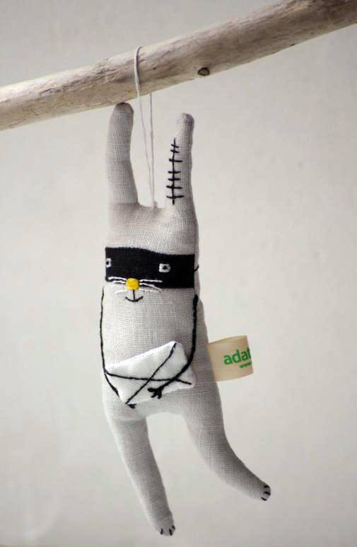 Rabbit is made from 100 % linen Inside - polyester stuffing.    * Hand embroidered body      Bandit is about 17 cm x 7cm /6,8 x 2,8 inch.        This