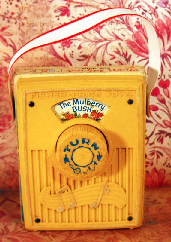 Vintage 1970 Yellow Fisher Price Baby Pocket Radio Music Box Toy - The Mulberry Bush. $10.00, via Etsy.