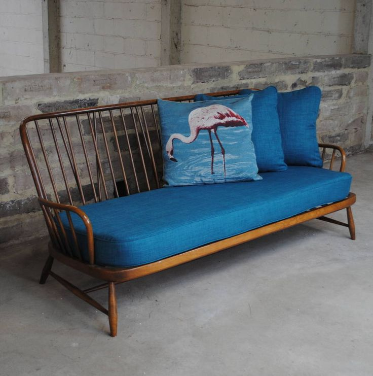 Vintage Ercol Jubilee Sofa In Teal from notonthehighstreet.com