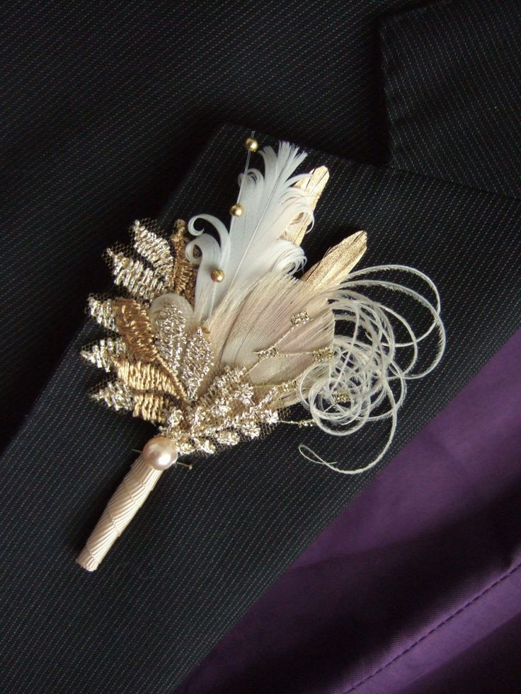 Handmade to order in 3 working days. A Beautiful Hand Made Boutonniere Corsage called Cia, in Gold Painted Pheasant Feathers Delicate White Curled Goose Nagoire a Bleached Peacock Feather, with Upcycled Vintage Lace Guipure in Light and Antique Gold, Diamond Cut Veiling, Gold bead spray and a single Light Gold Pearl, with stem wraped in Cream Petersham Ribbon.  Really Pretty accessory for the Bridal Party or Mother and Father of the Bride / Groom outfits for Vintage Inspired or Rustic Th...