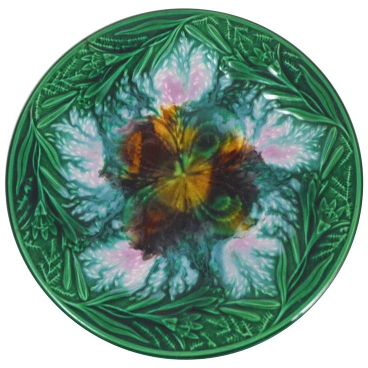 19th English Majolica Clover and Lilies Plate | From a unique collection of antique and modern dinner plates at https://www.1stdibs.com/furniture/dining-entertaining/dinner-plates/