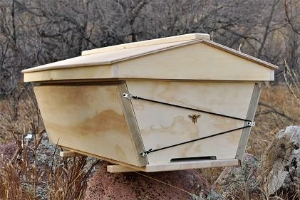 Insulation panels for the top bar hive in winter