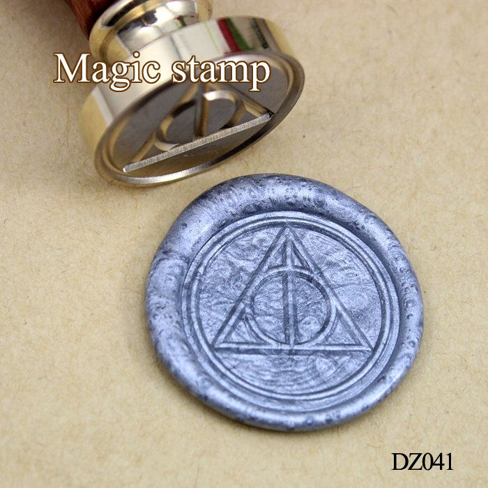 Deathly Hallows Symbol Wax Seal Stamp, Sealing wax ,wedding stamp ,party wax seal stamp,initial wax seal stamp set (DZ041) by MagicStamp on Etsy https://www.etsy.com/listing/216634047/deathly-hallows-symbol-wax-seal-stamp