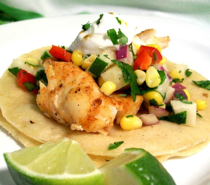 Cut corn off the cob for Fiery Fish Tacos with Crunchy Corn Salsa