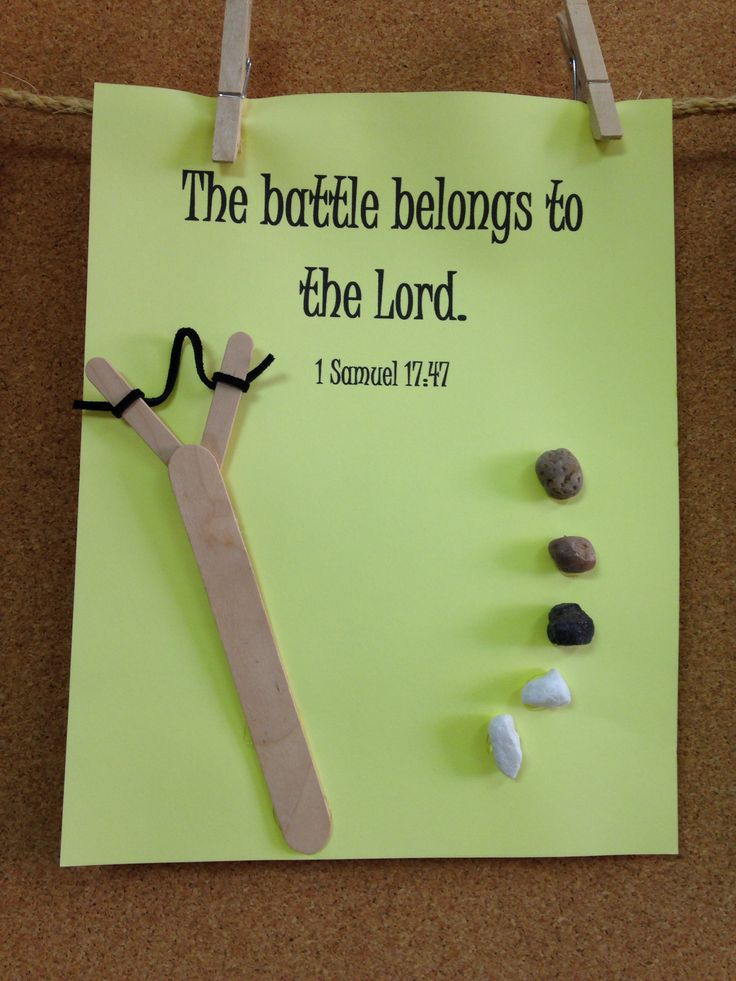 Simple David & Goliath craft with small stones, hot glue, Popsicle sticks, construction paper & leather jewelry cord.