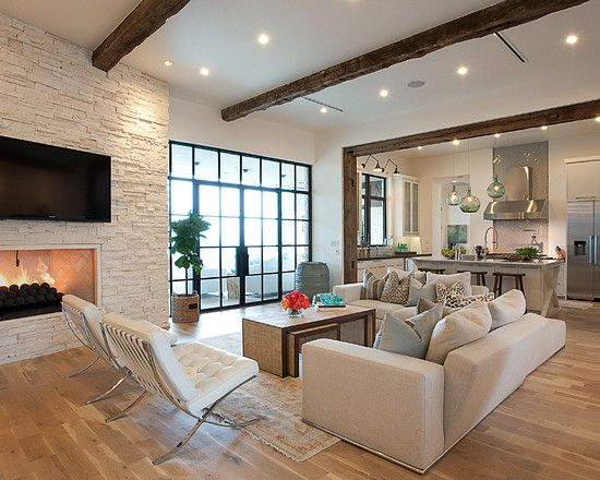 love the wood beams, especially around the archway | Cornerstone Architects, Cat Mountain Residence