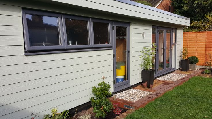 Cedral Weatherboard cladding on this Garden Office and integrated Garage built by Executive Garden Rooms