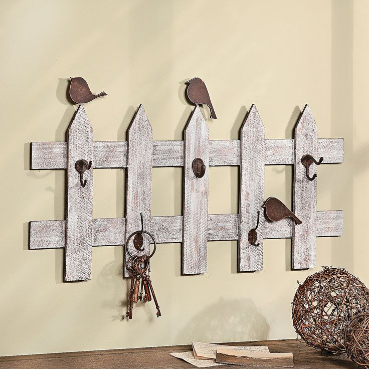 So the husband has somewhere to hang his uniform and pt clothes. Birds on a Fence with Decorative Hooks - TerrysVillage.com