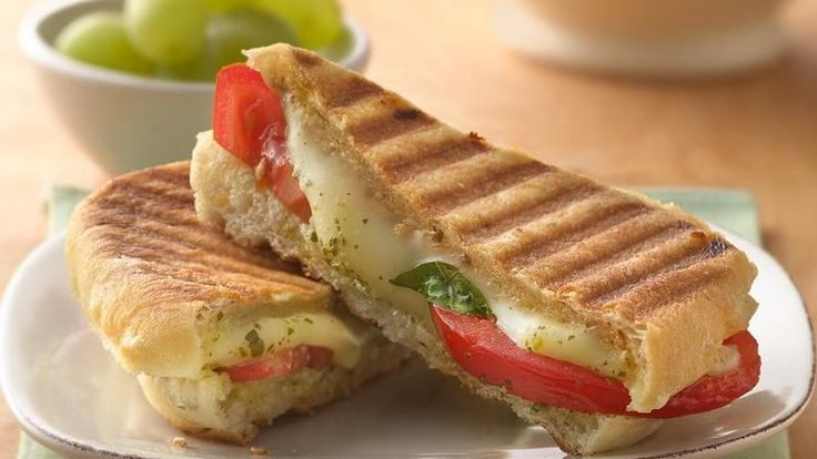 Dinner ready in 20 minutes! Enjoy classic grilled tomato and cheese sandwich with an Italian twist - a wonderful meal.
