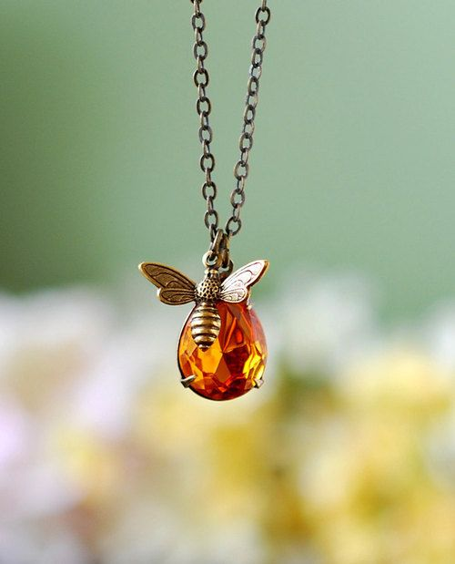 Honey Bee and Honey Drop Necklace  Crafted with a vintage, faceted, pear-shaped amber glass jewel and an antique brass bee charm. This neckl...