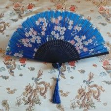 Fan: Oriental Style - Flower Blossom - Royal Blue & Peach.  The folding fan as we know it today originated in China and Japan 3000 years ago and were picked up by traders to sell to European countries. The Chinese and Japanese cultures created art forms with the fan; dance, opera, ceremonies, social occasions and the classical Geisha made the fan an importance status item.Great for weddings and parties.  Bamboo and painted silk, made in China.   Height 22cm – width 38cm, $12.00au