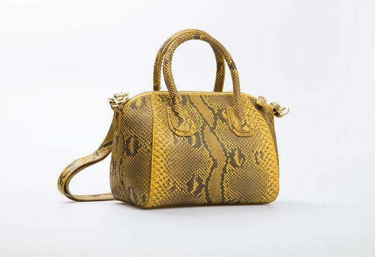 Antigona Gold Bag by Cupio. A pretty hand bag crafted from genuine phytoon leather in yellow color. Features with sling strap and has a little pocket inside the bag.  http://www.zocko.com/z/JJr73