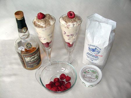 Cranachan: traditional Scottish dessert made with oatmeal, raspberries, cream, whisky, and honey. Sounds delicious, doesn't it? Apparently some recipes call for soaking the oatmeal overnight in some of the whisky: http://en.wikipedia.org/wiki/Cranachan