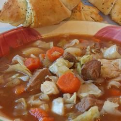 Beef and Cabbage Stew - 1 1/2 pounds beef stew meat, cut into 1-inch pieces   1 cube beef bouillon   2 cups beef broth   1 large onion, chopped   1/4 teaspoon ground black pepper   1 bay leaf   2 potatoes, peeled and cubed   4 cups shredded cabbage   2 celery ribs, sliced   1 carrot, sliced   1 (8 ounce) can tomato sauce   salt to taste