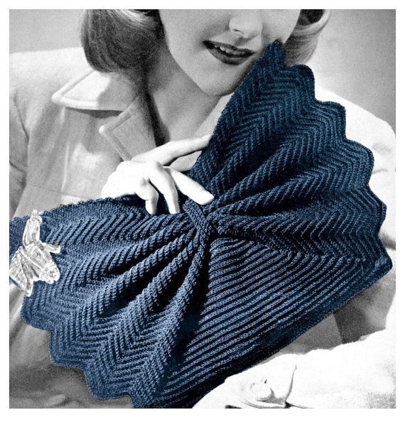 A dramatic vintage 40's clutch purse with a cinched bow center and fanned edge .. get creative with a Lucite or Bakelite zipper pull ! Crocheted with one large spool of Gimp and a No. 5 Steel hook