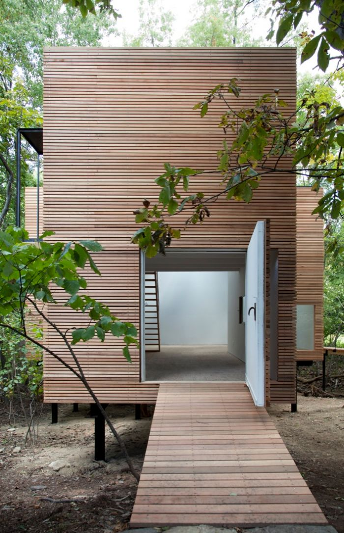 How fabulous would this be for as a yoga studio?  Cedar rain screen wraps around the building, Steven Holl, T Space Gallery