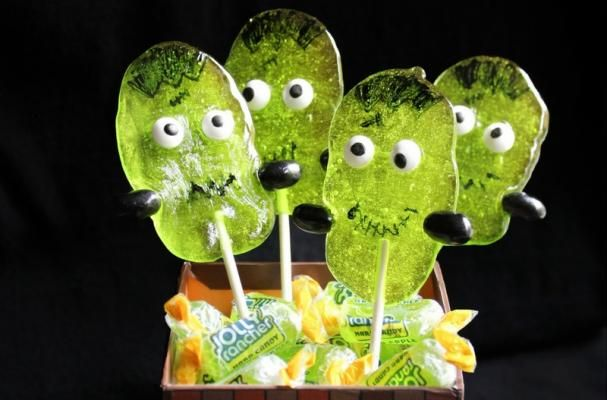 Super Cute Frankenstein Jolly Rancher Suckers  | You don't need lightning or a fancy laboratory to make these adorable creations. These cute Frankenstein Suckers are made using Green Apple Jolly Ranchers!