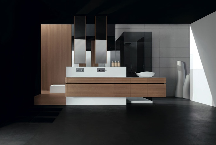 KUBIK 58 - Walnut cantilever composition, recessed handle lacquered Testa di Moro glossy, Corian top mod. Real 110. Milltek shower tray mod. Line. Built in Milltek bathtub mod. Ska. Walnut platform and wall panelling. Bracket for cantilever composition panelled with Corian.