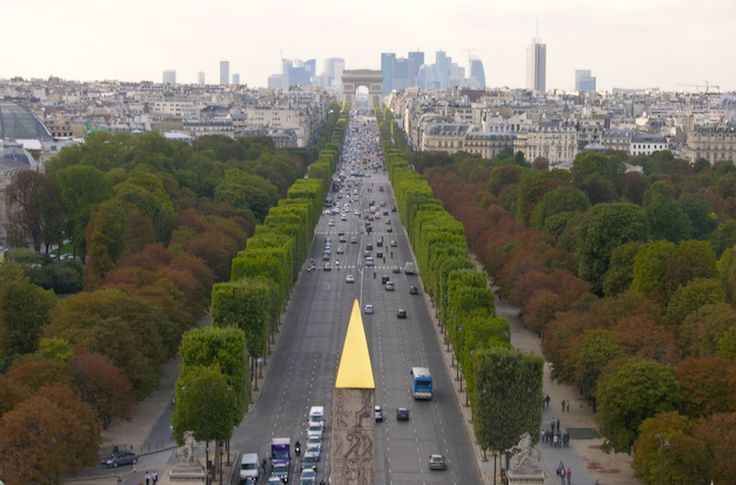 Avenue des Champs Élysées to the Arc de Triomphe and La Defense business center in the background.