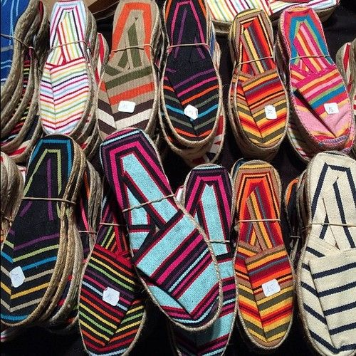 condenasttraveler: The night market in Biarritz, France, is filled with nice people, amazing food, and rows and rows of #espadrilles. #disp...