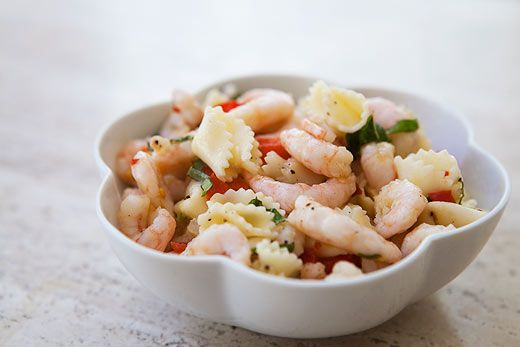 Simple shrimp and pasta salad, with an oil and lemon dressing, small pink shrimp, bell pepper, red onion, garlic, and basil.