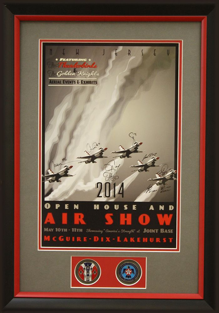Air show poster framed with black classic frame with red inner accent and custom mat boards cut to reveal medals.   Designed and framed at Art & Frame Express in Edison, NJ.