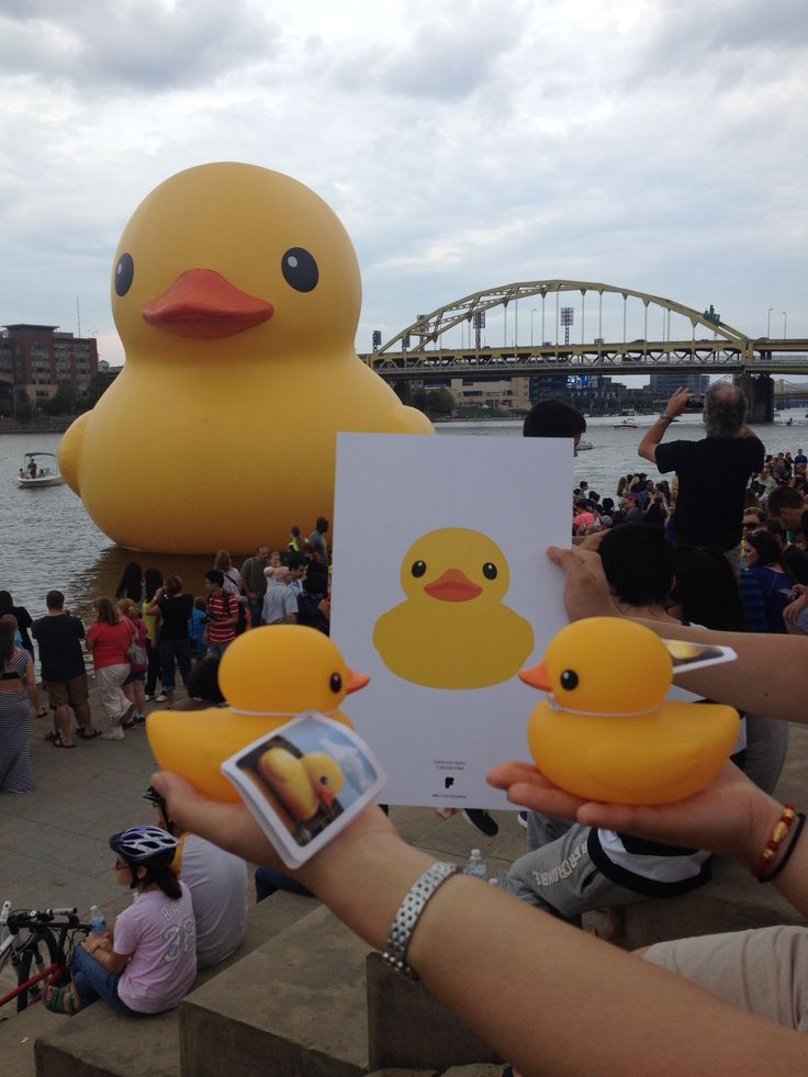 Giant rubber duck, replica duck, and poster