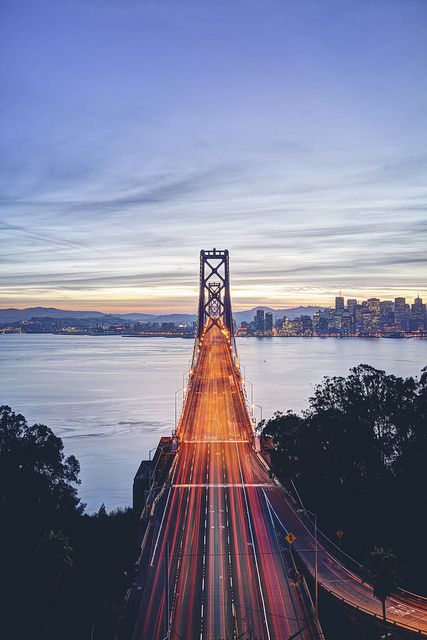 Vein by artchang, via Flickr: The bay bridge going west from Oakland to San Francisco is a fantastic sight at sunset during rush hour. Red tail lights only makes for quite a scene.