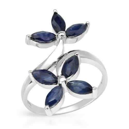 Ring With Genuine Sapphires -Size 7 Ring beautifully crafted with sapphires in 925 sterling silver. Total item weight 3.8g. Size 7. gemstone info: 7 sapphire, 2.10ctw., with marquise shape and blue color.