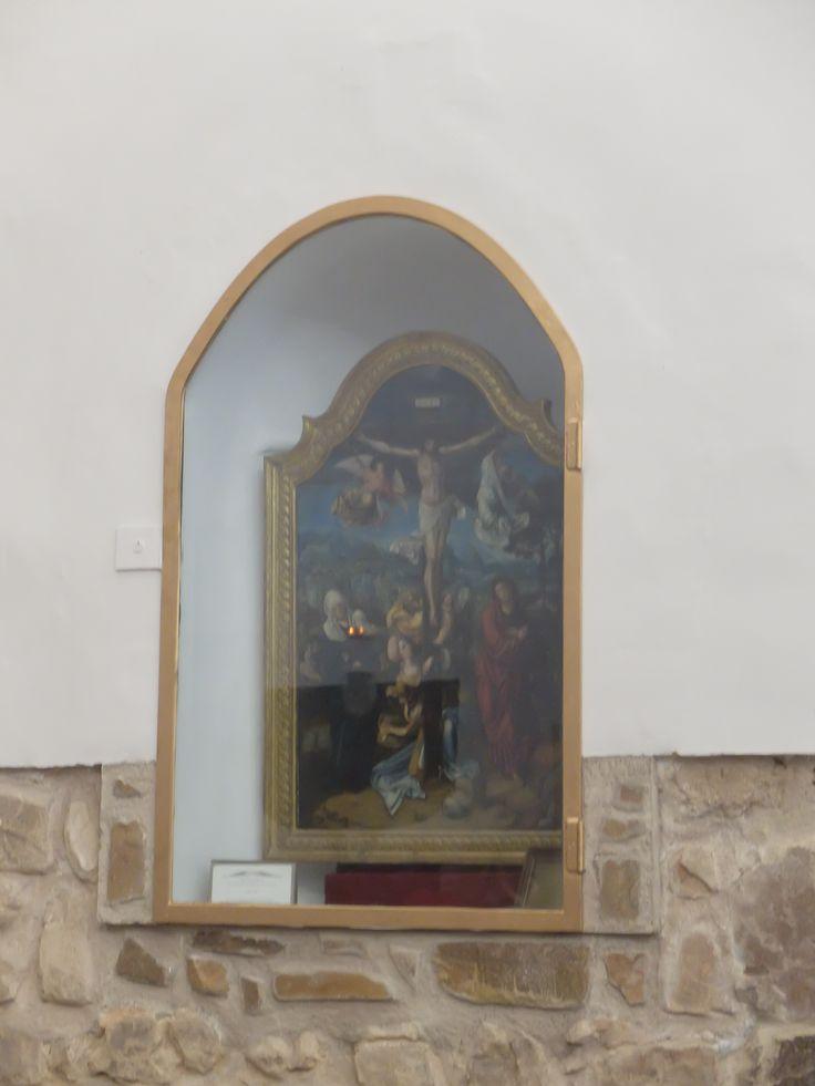 Iglesia. Hornacina con calvario de escuela flamenca en lado del evangelio.