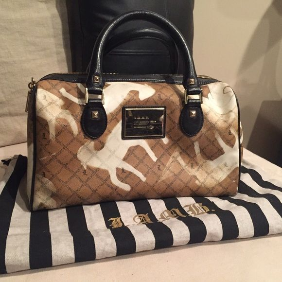 L.A.M.B. Handbag L.A.M.B. Handbag by Gwen Stefani-(re-listed!) I have loved this bag and it is in pristine condition. Comes with original dust bag. L.A.M.B. Bags Satchels
