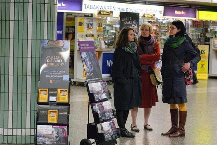 Frankfurt Germany - JW's using their rolling carts to bring literature to the people. (FREE)