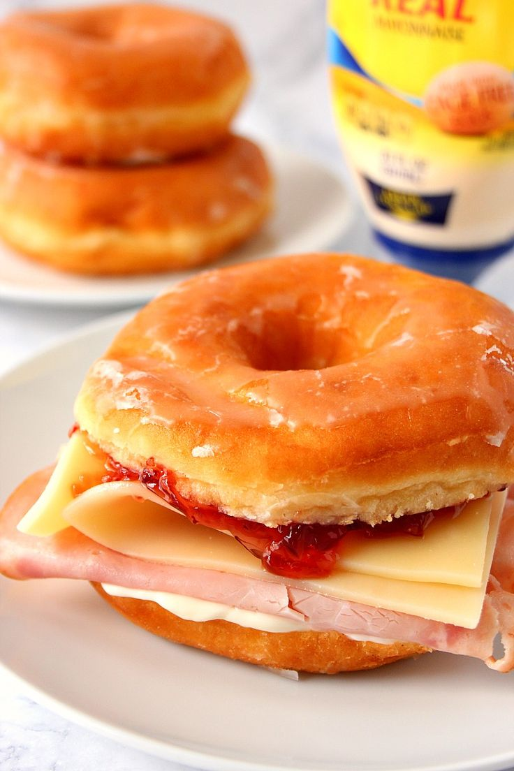 Donut Monte Cristo Sandwich Recipe - fresh from the bakery glazed donut with honey smoked ham, mayo, Swiss cheese and red currant jelly make for a strange but delicious combination!
