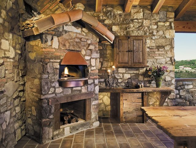 Love the outside patio with personal stone oven and fireplace!