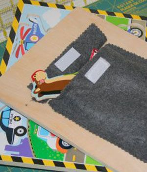 fabric pocket for puzzle pieces on the back of wood board puzzle. I NEED to do this for the magnet puzzles that have an extra piece!