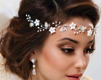 Wedding bohemian headpiece - bridal flower hair vine fits perfectly a bride hairstyle with long hair. It was manufactured from the highest quality components. You may choose gorgeous wedding vine from dropdown list. Exclusive bridal headpiece is very flexible so the hairdresser may easily put it in the right direction. Color of the metal findings (gold/silver) and tender flowers are to fit your brides dress (white or ivory). Many brides buy long accessories because it is a trend now. If you…