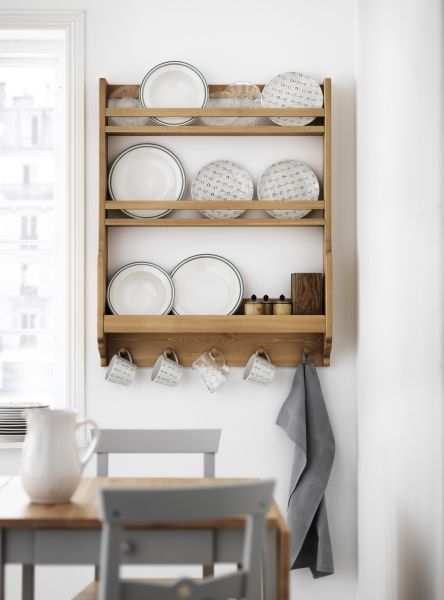 Have an awkward space in your dining room? A small wall can still serve as great display art for your dishware. Change it throughout the season to refresh the look inside as it does outside.