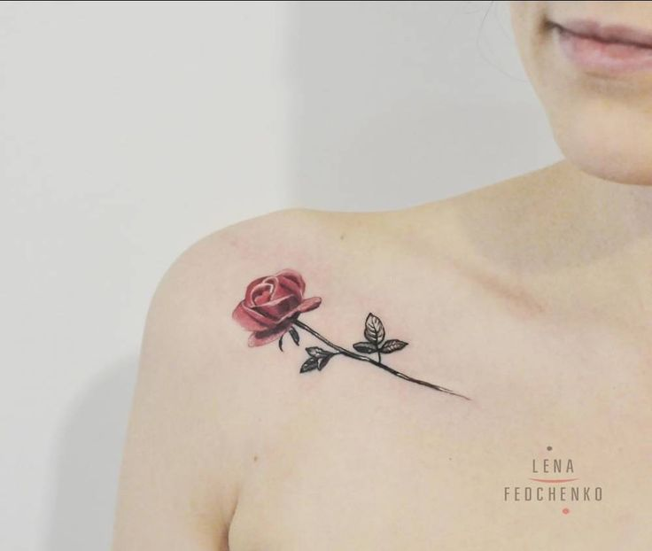 Red rose tattoo on the right rose.