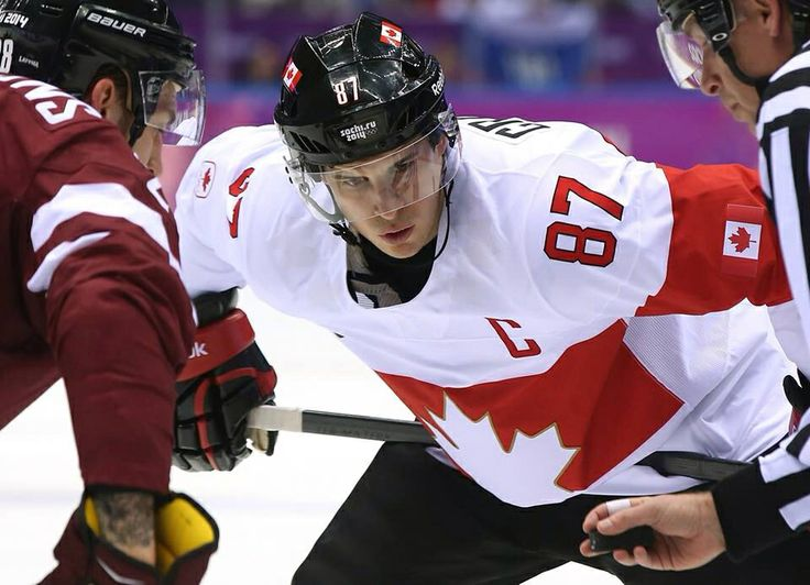 #SochiWinterOlympics #PittsburghPenguins #87 Sidney Crosby of Team Canada facing off against #28 Zemgus Girgensons of Team Latvia during Men's Ice Hockey Quaterfinals, February 19, 2014.