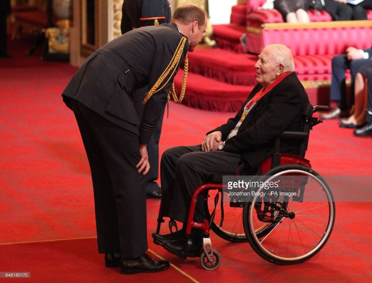 Sir Roger Bannister, who became the first man to break the four-minute mile, is made a Companion of Honour by the Duke of Cambridge at Buckingham Palace.