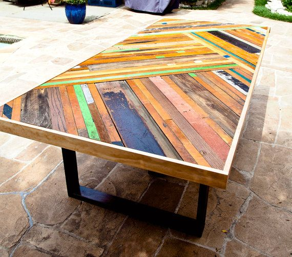 Custom Chevron Table by RandRDesignworks on Etsy.  Made from reclaimed bowling alley and gym flooring and other assorted reclaimed wood pieces.