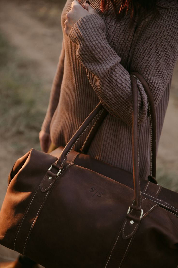Our mission is to preserve fine craftsmanship.  The hand-stitched duffle bag. www.swish-swank.com